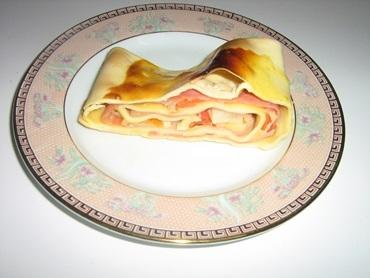 Rocambole de presunto e queijo